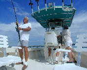 Roomy  boats rigged for tarpon fishing